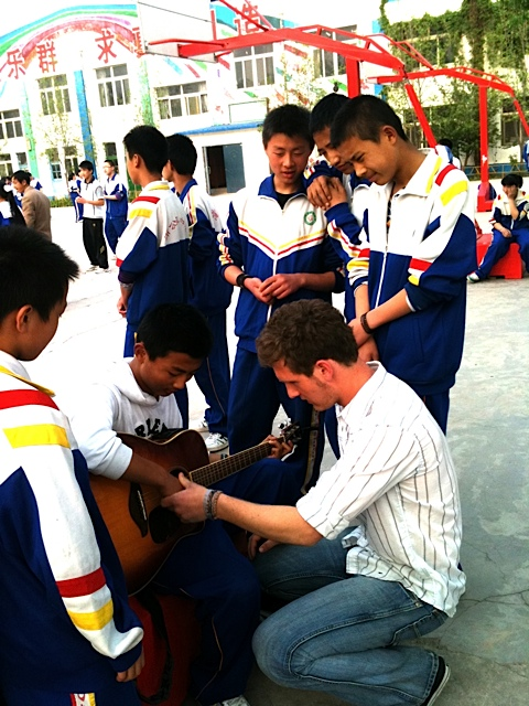 Chandler teaching guitar to chinese friends